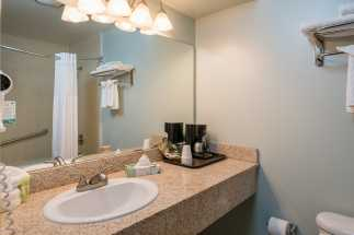 Morro Shores Inn Guest Rooms - Granite sink countertop and coffee maker