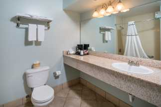 Morro Shores Inn Guest Rooms - Granite vanity and full private bathroom